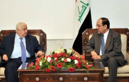 Walid al-Mouallem, ministre syrien des Affaires étrangères, reçu par Nouri al-Maliki, Premier ministre irakien, fin mai