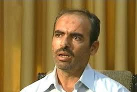 Hussein Harmouche devant la télévision syrienne d'Etat