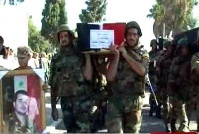 Obsèques de militaires tombés dans le secteur de Hama, le 8 octobre..