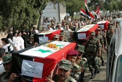 Obsèques de 13 victimes civiles et militaires du terrorisme, le 2 octobre à Homs
