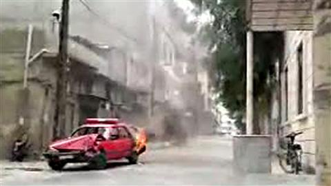 Véhicule de police incendié à Homs en mai dernier