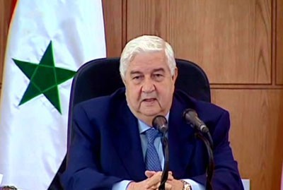 Walid al-Mouallem annonçant l'acceptation syrienne du protocole arabe