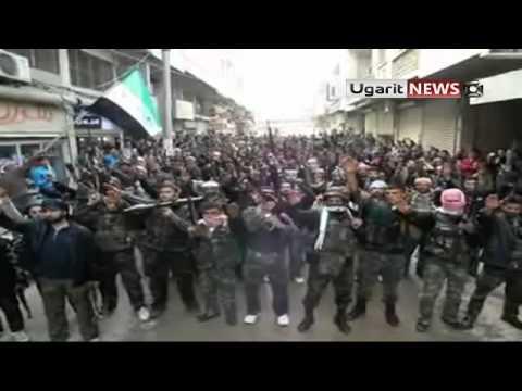 """Une vidéo de l'opposition, postée le 14 février, et ainsi légendée : """"Idleb : les soldats du bataillon Mou'awiya de l'ASL prêtent serment de protéger les manifestants pacifiques, de lutter contre le régime assassin et de respecter l'ensemble des accords internationaux"""" (ce dernier point peut être considéré comme un signe amical à Washington et à l'OTAN)"""
