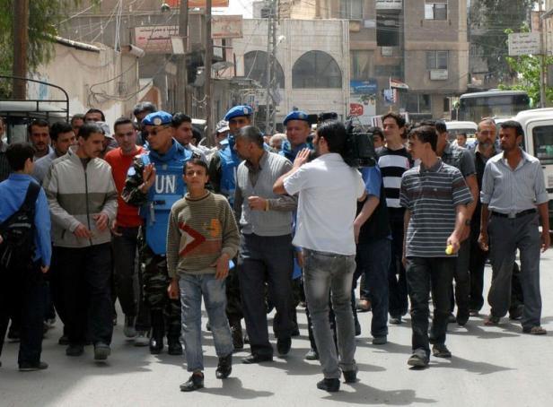 Premiers pas des premiers observateurs, à Damas le 18 avril